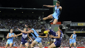 Carlton's Andrew Walker flies high against the Fremantle Dockers last ...