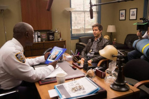 Andy Samberg (L) and Andre Braugher (R) bust guest star Michael Grant ...