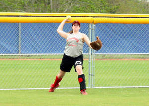 Beth Wilson fields a ball in the outfield during drills on Friday.