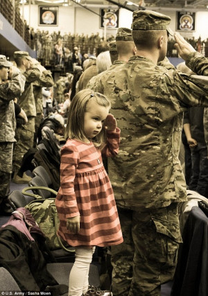 Yes sir: Daniella, daughter of Capt. Dan Moen, salutes just like her ...