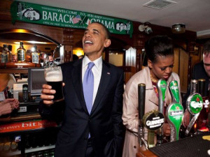 President Obama talks with pub-goers as First Lady Michelle Obama ...