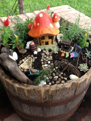 What a cute little fairy garden in a bucket, perfect for creative play ...