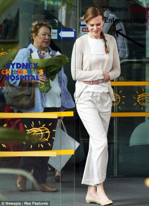 Demure: The Moulin Rouge star was dressed casually in cream for her ...