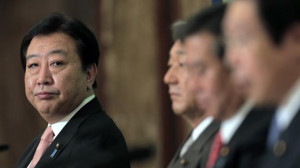 Japanese Prime Minister Yoshihiko Noda glances at Democratic Party ...