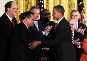 Mark Pryor U S President Barack Obama 3R shakes hands with Sen