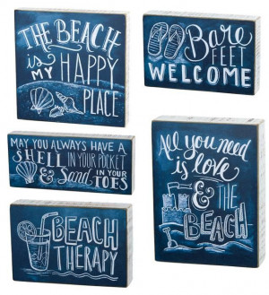 Beach chalk signs with sayings.