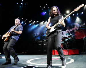 ... band Rush, performing live in 2007, with drummer Neil Peart in the