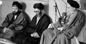 ... (centre) with Ahmad Khomeini (L) and Ayatollah Khomeini - File photo