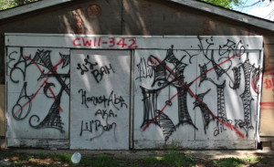 ... gang based in southern Indianapolis. A rival gang sprayed red Xs over