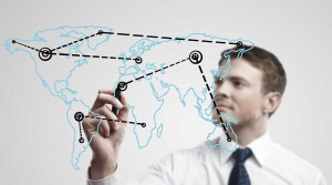 Young business man drawing a global network or globalization concept ...