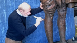 Sculptor Philip Jackson working on the statue