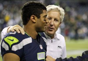 head coach Pete Carroll, right, walks with quarterback Russell Wilson ...