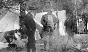 Photo of John Burroughs and Theodore Roosevelt standing in a camp with ...