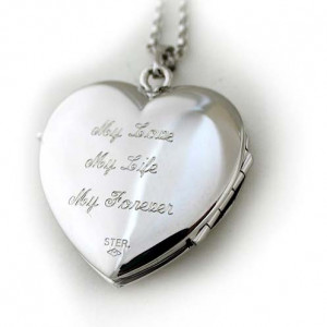 showing a locket with an engraved sentiment saying:
