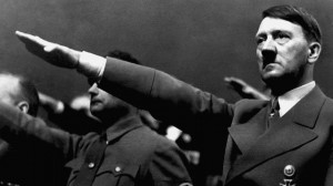 Photo: Adolf Hitler giving the Nazi salute during a rally in 1939 ...