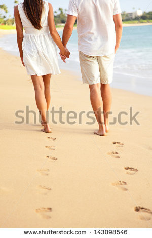 Couple holding hands walking romantic on beach on vacation travel ...
