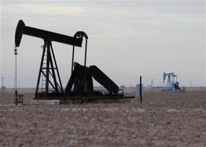 Oil rigs are seen in Midland, Texas May 9, 2008. Oil jumped to a ...