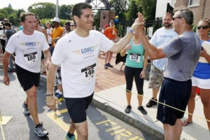 He ran with his wife and a team of eight campaign volunteers