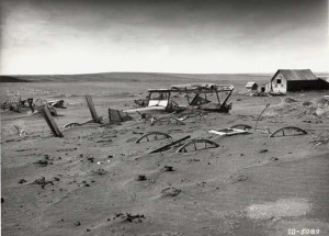 Farm buried in dust during the Dust Bowl Years.