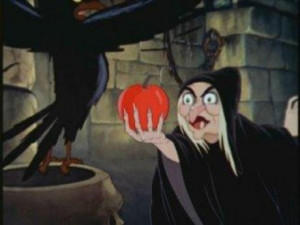 Snow White and the Seven Dwarfs - The Queen holds the poison apple