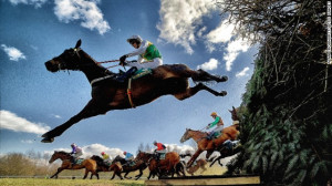 Aintree, Liverpool, UK: Horses and jockeys negotiate the famous ...