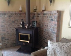 Please help! I would so love to redo this UGLY fireplace made of brick
