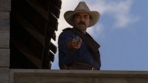 Monte ( Tom Selleck ) takes aim with his Colt 1873 Single Action Army ...
