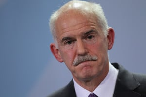 ... colleagues told George Papandreou that he had to resign for the