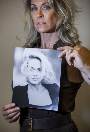 Accuser, Barbara Bowman holds picture of herself as aspiring 17 yr ...