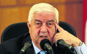 DIGGING IN Syria s Foreign Minister Walid al Muallem speaks during