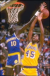 Manute Bol is so skinny they save money on road trips. They just fax ...