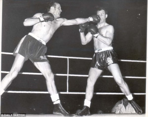 Lethal left hand: Sir Henry Cooper lands one on the money during his ...