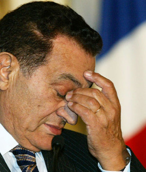 Egyptian President Hosni Mubarak rubs his eyes during a joint press ...