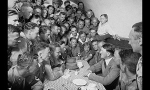 propaganda photograph showing Hitler speaking to followers in the ...