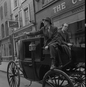 Patrick Kavanagh and Anthony Cronin seated on horse and carriage