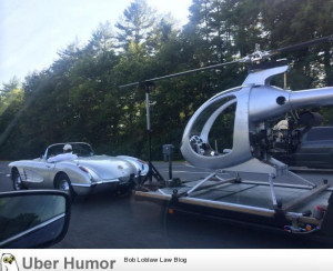 50′s corvette towing a helicopter. this guy is winning at life.