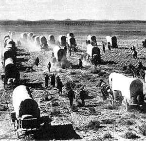 group of Mormon Pioneers going about the hard and dirty job of ...