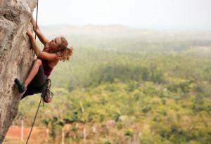 Woman rock climbing in Vinales, Cuba.