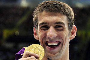 Michael Phelps of the U.S. celebrates with his gold medal at the men's ...