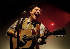 Marcus Mumford with his Martin & Co. guitar. I believe it's a D-28 ...