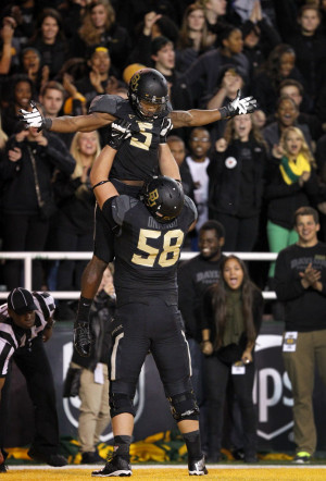 Baylor wide receiver Antwan Goodley (5) is hoisted by offensive ...