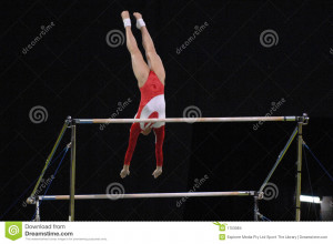 ... gymnast preforms a routine on the uneven bars during competition