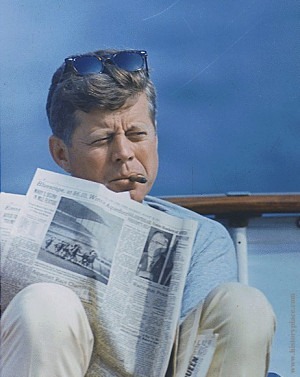 John F. Kennedy smoking a cigar.