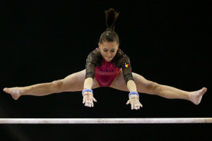 Iordache performs on uneven bars during the 6th Doha Art Gymnastics ...