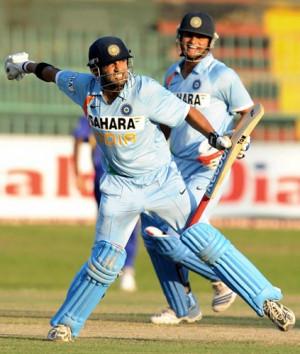 Gautam Gambhir celebrates the after scoring a century as team mate ...