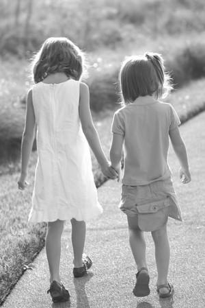 sisters walking away.. by winterdew