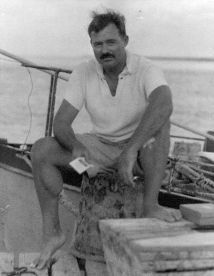 EH06670P Ernest Hemingway sitting on dock next to his boat, Pilar ...
