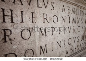 Latin words engraved on a column in Roman Capitol - stock photo