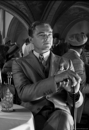 Describe Nick Carraway briefly and his apparent role in the novel.