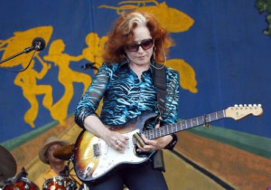 Bonnie Raitt performs at the New Orleans Jazz and Heritage Festival in ...